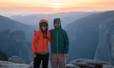 Alison and Sean of Evenfall Photographers, Pacific Northwest outdoor adventure photographers, at sunset in Yosemite National Park, with El Capitan in the background.